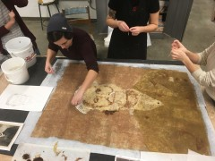 Students creating portrait with paper