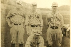 a vintage photo of four male baseball players wearing Indiana uniforms