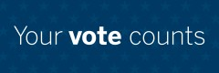 "Banner with a dark blue field, blue stars, and white text that reads ""You Vote Counts""."