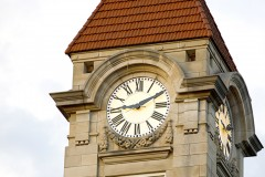 A close up image of a limestone clock tower at IU Bloomington