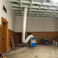 A photo of a room with wood work and an elegant ceiling under construction