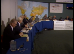A still image captured from a video depicts Soviet and American military personnel at a roundtable on nuclear disarmament.