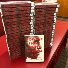 "A stack of 40 paperback books with the title, ""How we fight white supremacy"""