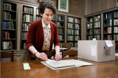 Isabel Planton is a librarian at Lilly Library. She is shown here in the Ellison room with a Vonnegut manuscript.