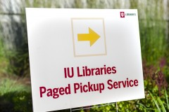 A photo of a yard sign with the words IU Libraries Paged Pickup Service