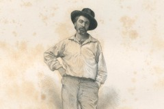 Portrait of Walt Whitman, in an open-necked shirt, one hand on his hip, hat cocked to the side