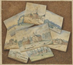 A stack of watercolors depicting early images of Indiana University is shown on top of a table