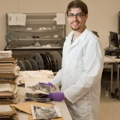photo of intern inside the Moving Image Archive workroom