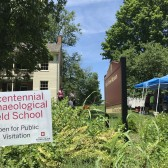 Fieldwork sign in front of the Wylie House and students working under tent