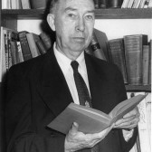 Stith Thompson in front of a bookshelf