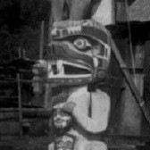 Detail of a totem pole in Alert Bay, British Columbia, 1914. Photograph by Edward Curtis.