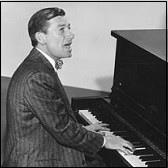 Hoagy Carmichael singing and playing the piano