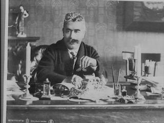 Isaac Leib Peretz (1852-1915), master of modern Yiddish literature, Yiddish and Hebrew poet, dramatist and short-story writer, poses for a portrait at his desk in his study.